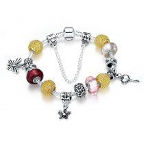 Ezüsttel és arannyal bevont pillangós charm karkötő üveggyöngyökkel + AJÁNDÉK DÍSZDOBOZ (0684.)