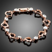 Rózsaarannyal bevont szív karkötő áttetsző stellux ausztriai kristályokkal + AJÁNDÉK DÍSZDOBOZ (0205.)